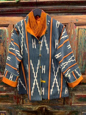 Front of a orange stripped West Africa Baule Jacket.