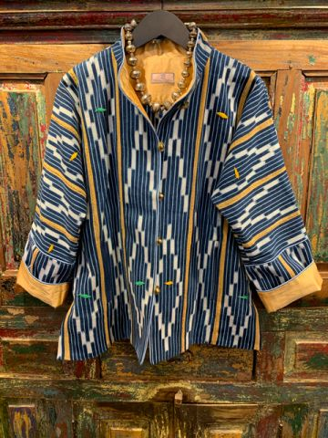 Front of a yellow stripped West Africa Baule Jacket.